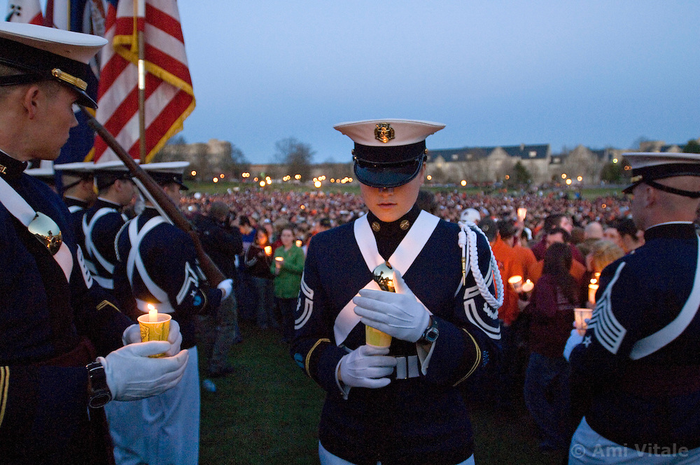 Blacksburg, Va. UNITED STATES: Virginia Tech Cadets light candles as they and other mourners grieve at a candlelight vigil for the victims of the shooting massacre at Virginia Tech University in Blacksburg, Virginia April 17, 2007. A 23-year-old student from South Korea was identified as the gunman who carried out the deadliest school shooting in US history.  33 people died on Monday, police named the gunman as Cho Seung-Hui, a student at the school and resident alien in the United States. (AMi Vitale)