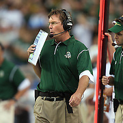 SHOT 8/31/08 6:25:55 PM - Colorado State head football coach Steve Fairchild (center) works the sidelines during the first half of their 2008 Rocky Mountain Showdown game against Colorado at Invesco Field at Mile High in Denver, Co. Colorado won the game 38-17 before a crowd of nearly 70,00. The rivalry game featured the debut of new Colorado State head football coach Steve Fairchild and the debut of highly recruited Colorado tailback Darrell Scott. Fairchild was the offensive coordinator for the Buffalo Bills last year. Fairchild graduated from Colorado State University in 1980 with a degree in economics..(Photo by Marc Piscotty / © 2008)