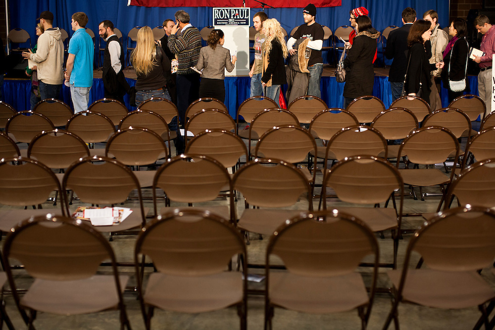 People wait in line to have their picture taken with Republican presidential candidate Ron Paul after a Salute to Veterans Rally on Wednesday, December 28, 2011 in Des Moines, IA.