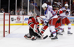 Oct 5, 2009; Newark, NJ, USA; New Jersey Devils goalie Martin Brodeur (30) makes a save on a shot by New York Rangers center Brian Boyle (22) during the first period at the Prudential Center.