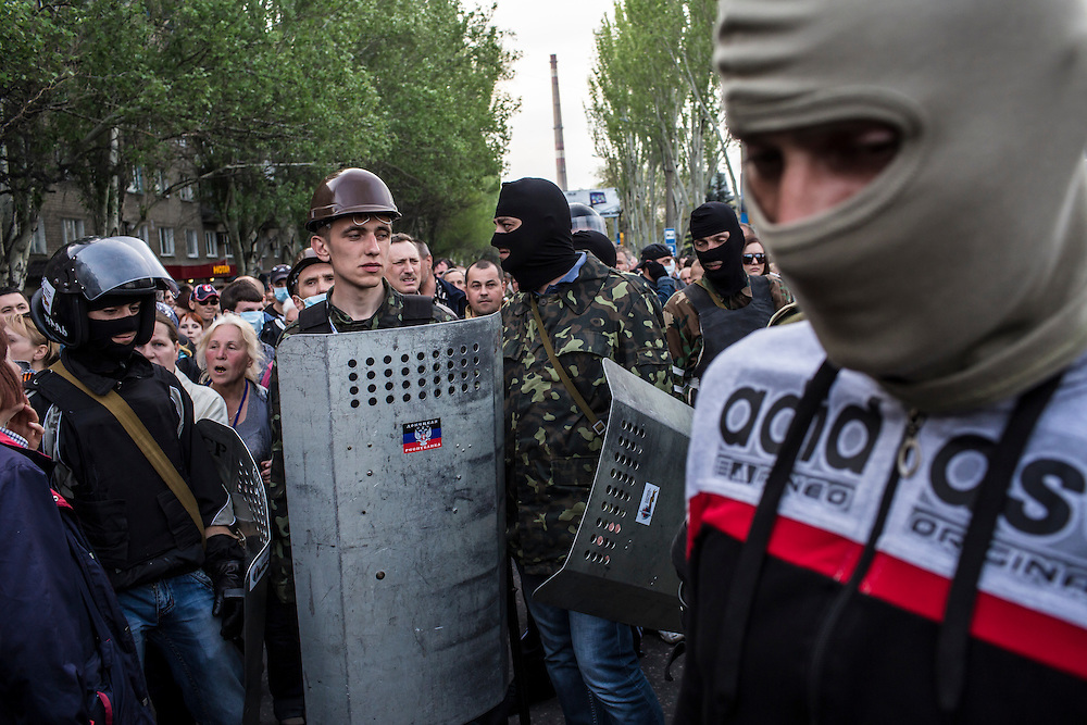 DONETSK, UKRAINE - MAY 4: Pro-Russian protesters stand outside after occupying and ransacking the military prosecutor's office on May 4, 2014 in Donetsk, Ukraine. Cities across Eastern Ukraine have been overtaken by pro-Russian protesters in recent weeks, leading the Ukrainian military to respond with force in some areas. (Photo by Brendan Hoffman for The Washington Post)