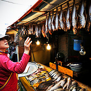 A vendor takes inventory at her fish stall in Oncheonjang Market in Busan, September 10, 2010.