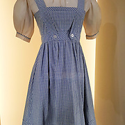 Farm girl dress worn by Judy Garland as Dorothy Gale in The Wizard of Oz, 1939. This photo is from the EMP Museum, now called MOPOP (Museum of Pop Culture), Seattle, Washington, USA. For licensing options, please inquire.