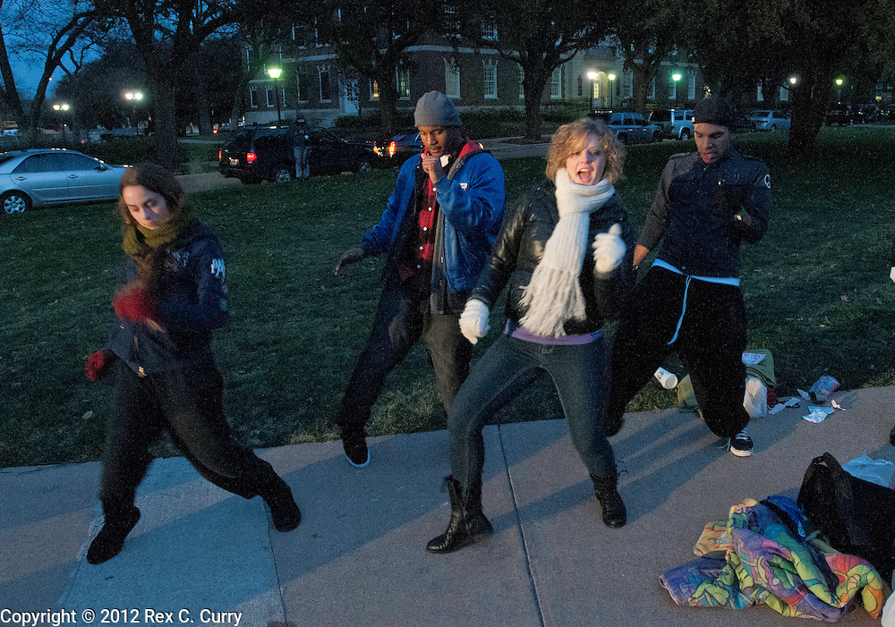 """Sarah Guarino, left, from Cypress, Tx. Aaron Blaylock, from Dallas, Codi Starner from Phoenix  and Matt Rodriguez, from Lawrence, Ks. work on their dance moves after meeting while waiting in the early morning cold to audition for """"So You Think You Can Dance"""" at SMU on Friday, Jan. 13, 2012."""
