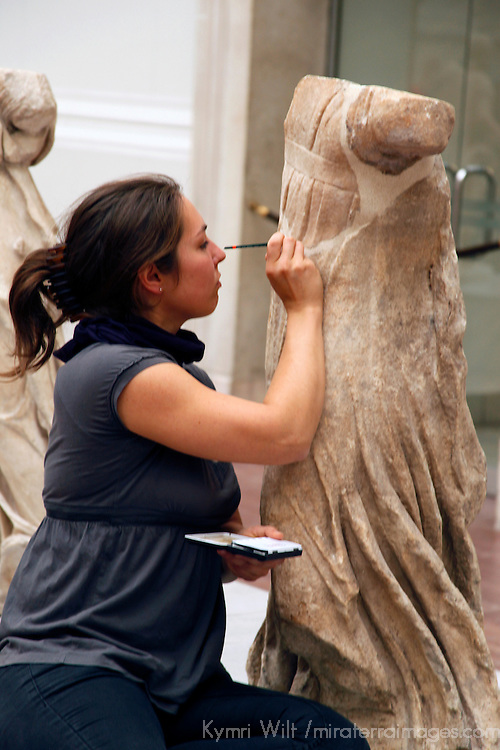 Europe, Germany, Berlin. Pergamon Museum restoration worker.