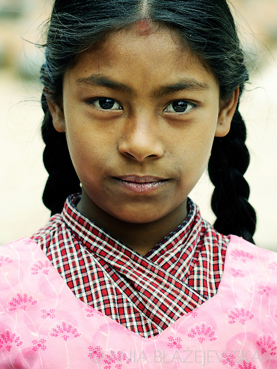 Nepal, Bhaktapur. Portait of a girl with pigtails.