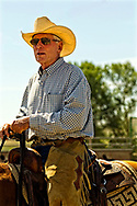 Tom McGuane, author, competes in cutting horse competition, Big Timber, Montana