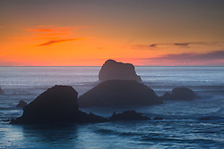 """""""Plaskett Rock at Sunset 2"""" - Photograph at sunset of Plaskett Rock and other rocks along the Pacific Ocean shoreline in the Big Sur area of California."""