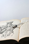An open Anatomy text book and syringe