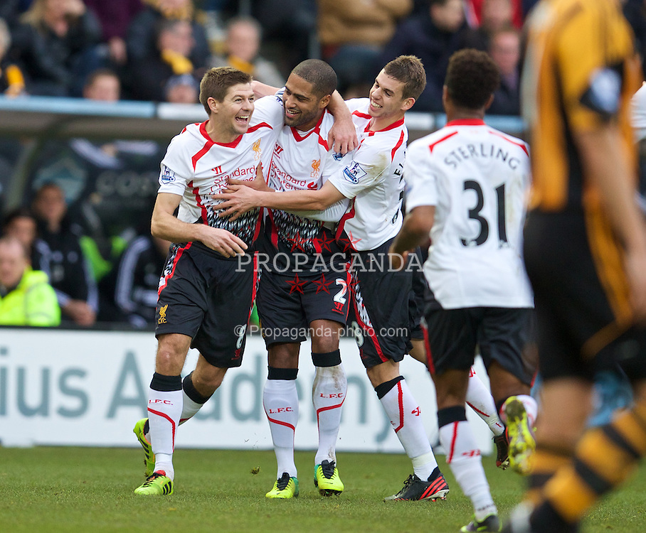 HULL, ENGLAND - Sunday, December 1, 2013: Liverpool's captain Steven Gerrard celebrates scoring the first goal against Hull City with team-mates Glen Johnson and Jon Flanagan during the Premiership match at the KC Stadium. (Pic by David Rawcliffe/Propaganda)