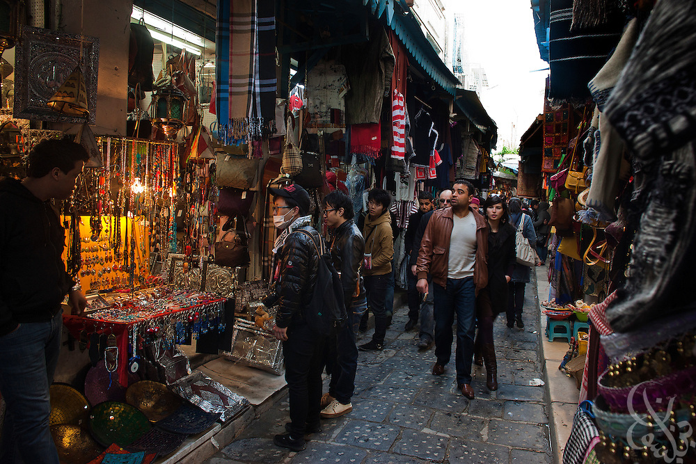 Foreign tourists shop in the old medina area March 05, 2012 in Tunis, Tunisia. The area is normally crowded with foreign tourists, however in the year since the revolution tourism numbers are dramatically down.