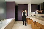 women in bathroom with towel