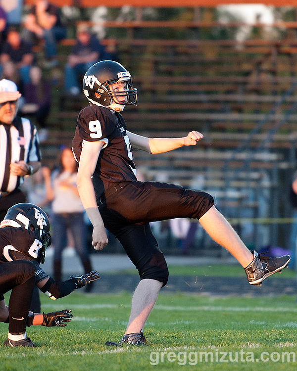 Vale senior Jakob Jernsletten follows on his PAT with Gage Fortin the holder. Vale - Burns football game, September 18, 2015 at Vale High School, Vale, Oregon. Vale won 65-28.