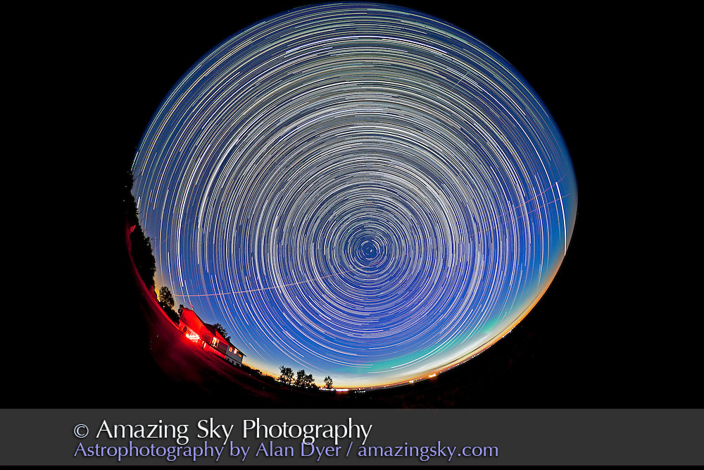 Circumpolar star trails taken from 11:45 pm to 3:30 am, July 5/5, 2011, using 8mm Sigma fish eye lens and Canon 5D MkII camera, for stack of 275 exposures, each 40 seconds at f/4 and ISO 1000. Stacked with Chris Schur's Photoshop Action. There are also noctilucent clouds and aurora in the scene, looking north from home in southern Alberta, latitude +51°.