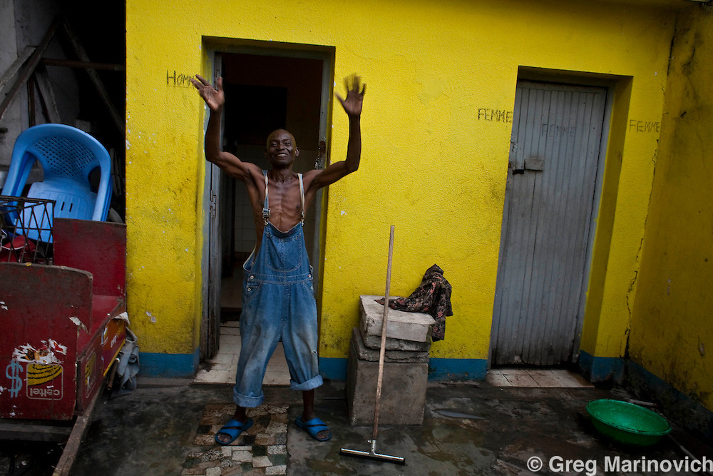 KINSHASA, DRC DEC 28, 2007:  The morming after New Year's Eve at the bar and night-club Montoise, run by a medical doctor Papy Matombe in the Limete district of the capital of the Democratic Republic of Congo. Photo Greg Marinovich