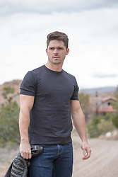 sexy man on a dirt road