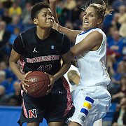 Northeastern forward Jewel Tunstull (42) attempts a shot as Delaware Forward Elena Delle Donne (11) defend in first half of an NCAA college basketball game against Northeastern Sunday, Feb. 26, 2012 at the Bob Carpenter Center in Newark, Del.