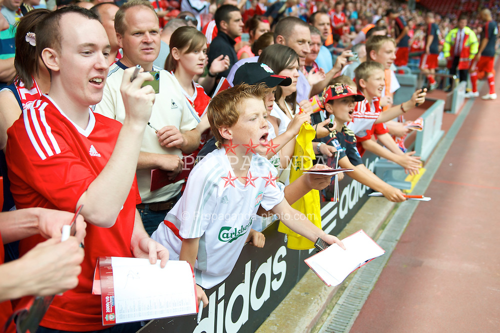 LIVERPOOL, ENGLAND - Saturday, August 8, 2009: Young Liverpool supporters wait for an autograph from a player before a pre-season friendly match against Club Atletico de Madrid at Anfield. (Pic by: David Rawcliffe/Propaganda)