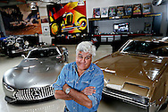 The Tonight Show host and actor and comedian Jay Leno stands next to some of his collectible cars at Big Dog Garage in Burbank, CA on Monday, December 2, 2013.(Photo by Sandy Huffaker/Redux Pictures)