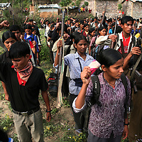 Members of the People?s Liberation Army, the Maoist rebels that have been fighting for control of the country, stand in formation in a remote part of western Nepal on June 22, 2006. The ten-year old conflict in Nepal has claimed an estimated 13,000 lives. (Photo/Scott Dalton)