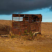 Rusted horse trailer on a farm at Ka Lae, South Point, Hawaii