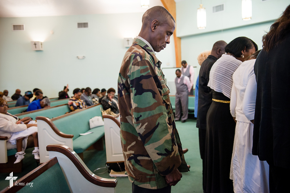 Ronald Pickett prays with parishioners during worship at Trinity Lutheran Church Sunday, April 6, 2014, in Mobile, Ala. LCMS Communications/Erik M. Lunsford