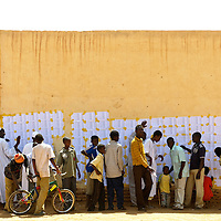 Khartoum, Sudan 11 April 2010<br /> Sudanese citizens check the voter lists in a polling station during the presidential elections in Sudan.<br /> Photo: Ezequiel Scagnetti