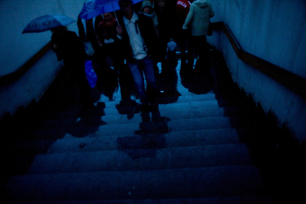 People emerge from a tunnel under the street during a rainstorm in Kazan, Russia, on Friday, September 21, 2007.