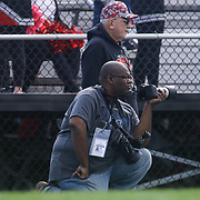 New Journal photographer Andre Smith watches the game from the sidelines during a regular season football game between William Penn and Concord Saturday, Oct. 24, 2015 at  William Penn High School in New Castle.