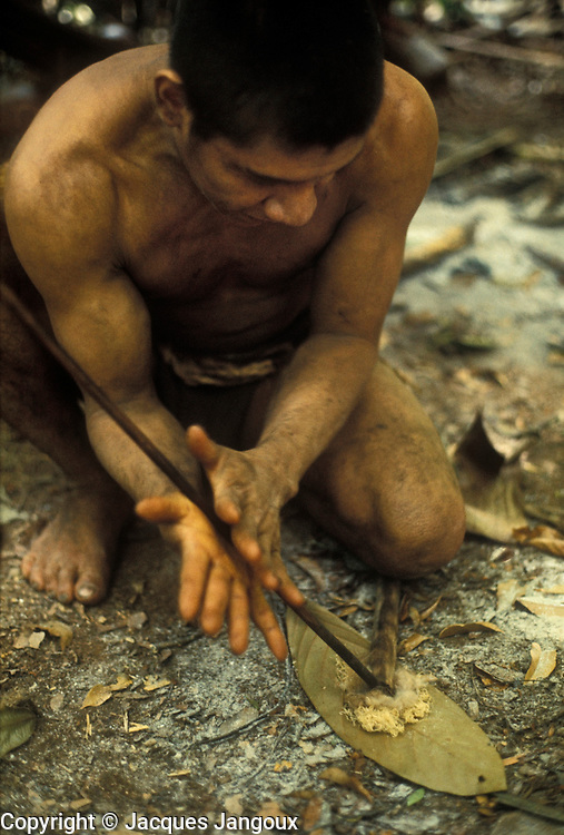 Use of forest products by Indians of Guiana Highlands of Venezuela: Hoti Indian man making fire with a fire drill (conversion of mechanical energy to thermal energy)