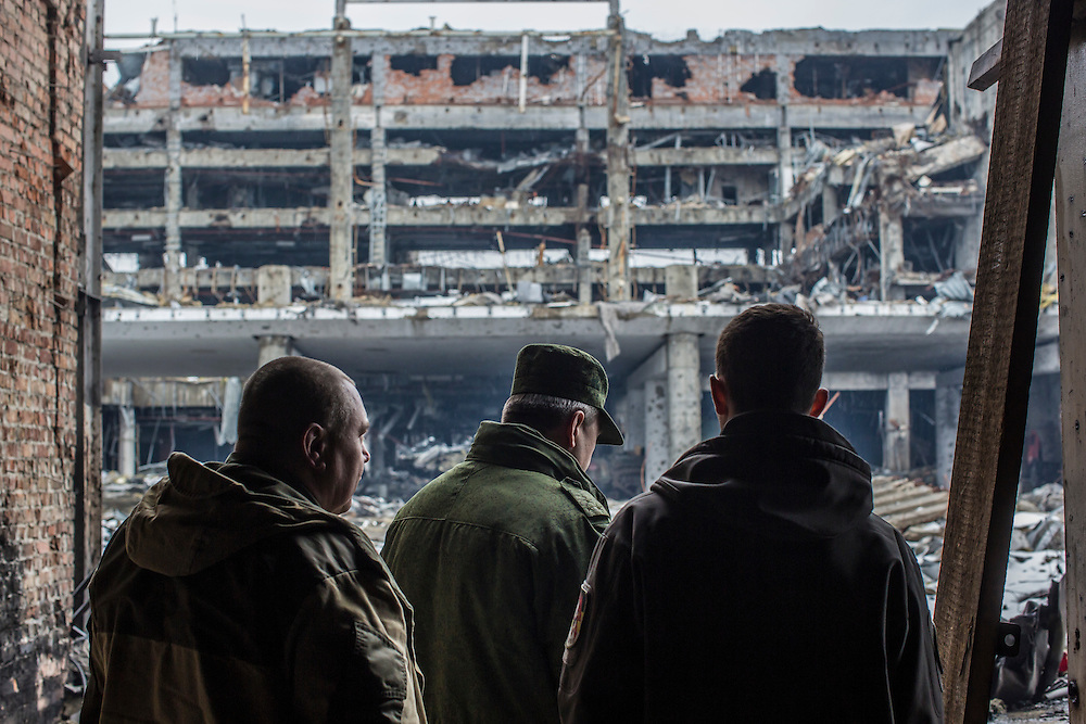 Eduard Basurin, center, the defense minister of the Donetsk People's Republic, with some of his fighters at the ruins of the Donetsk Airport on Tuesday, March 22, 2016 in Donetsk, Ukraine.