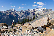 Hike to Burgess Pass to admire the President Range above Emerald Lake in Yoho National Park, British Columbia, Canada. Walk here between Mount Field and Mount Wapta beneath the famous Burgess Shale Formation (a side trail only accessible with BSGF licensed guides), one of the world's most celebrated fossil fields, famous for its extraordinary diversity and preservation of the soft parts of Middle Cambrian animals (505 million years old). The Emerald Triangle makes a fine hike of 20 km (12 miles, with 3200 feet gain) around Emerald Lake and over Burgess Pass and Yoho Pass. Yoho is one of several Canadian Rocky Mountains parks which comprise a spectacular World Heritage Area listed by UNESCO in 1984.