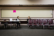 Two women chat as one waits for her take-out lunch order at the Aliquippa Croatian Center in Aliquippa. PA.