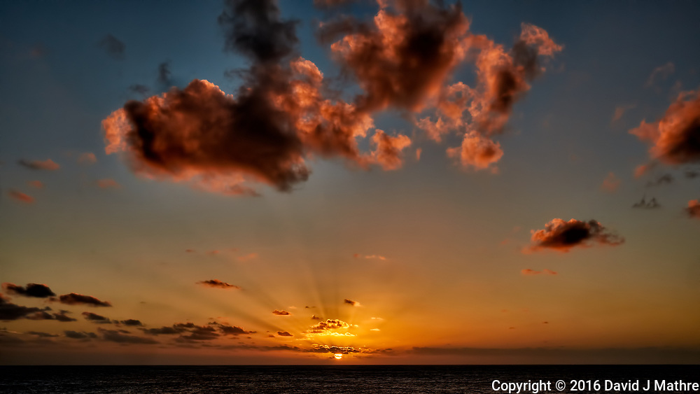 Sunset and clouds over the Pacific Ocean from the deck of the MV World Odyssey. Semester at Sea, 2016 Spring Semester Voyage. Day 3 of 102. Image taken with a Fuji X-T1 camera and 23 mm f/1.4 lens (ISO 200, 23 mm, f/16, 1/125 sec).