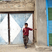 A young boy poses for a portrait in the Suru Valley, Kargil District, India