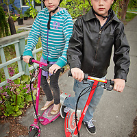 Kyle and Morgan Johnson on their electric scooters, South Addition, Anchorage