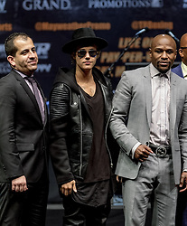 LOS ANGELES, CA - MAR 10 Justin Bieber sneaks after the Mayweather vs Pacquiao press conference at the Nokia Theater in Los Angeles, California USA to promote their upcoming bout at the MGM Grand in Las Vegas, NV May 2, 2015. This is the ony presser. 2015 Feb 9. Byline, credit, TV usage, web usage or linkback must read SILVEXPHOTO.COM. Failure to byline correctly will incur double the agreed fee. Tel: +1 714 504 6870.