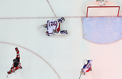 May 21, 2012; Newark, NJ, USA; New Jersey Devils right wing Dainius Zubrus (8) celebrates a goal by New Jersey Devils center Travis Zajac (19) while New York Rangers goalie Henrik Lundqvist (30) lies on the ice during the first period in game four of the 2012 Eastern Conference Finals at the Prudential Center.  The Devils defeated the Rangers 4-1.
