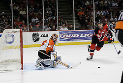 Mar 30, 2007; East Rutherford, NJ, USA; New Jersey Devils center Jim Dowd (12) looks for the Philadelphia Flyers goalie Martin Biron (43) rebound during the third period at Continental Airlines Arena in East Rutherford, NJ.