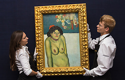 """Sotheby's, Mayfair, London, October 9th 2015. Expected to fetch up to $60,000,000 at auction, Sotheby's presents """"the finest Blue Period Picasso to come to market in a generation"""", painted in 1901 when Pablo Picasso was just shy of 20 years old. PICTURED: Sotheby's Gallery Technicians hang the Picasso for the London preview ahead of its New York auction. // Contact: paul@pauldaveycreative.co.uk Mobile 07966 016 296"""
