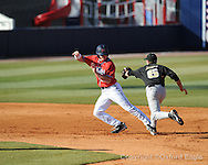 Mississippi's David Phillips is tagged out vs. Oakland in Oxford, Miss. on Friday, February 26, 2010. Ole Miss won 9-1.