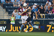 Ciaran Clark of Aston Villa and Antoine Hoppenot of the Philadelphia Union\ go up for a headball during a match between Aston Villa FC and Philadelphia Union at PPL Park in Chester, Pennsylvania, USA on Wednesday July 18, 2012. (photo - Mat Boyle)