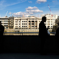UK. London. People in front of London's Bankside developments between Southwark Bridge and The Tate Modern.