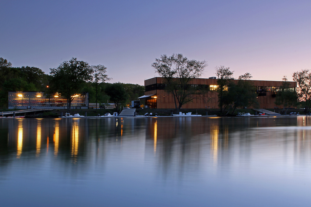 The architecture photography image of the aesthetics and modern Community Rowing boathouse landmark on the banks of the Charles River in Brighton, Massachusetts just outside of Boston  was taken in May 2014 on a beautiful night at twilight, only minutes after sunset. Twilight provides amazing opportunities for photographers and provides the artist with unique lighting that makes for exceptional skyline and cityscape photography pictures.  <br /> The Community Rowing boathouse was designed by Anmahian Winton Architects and opened its doors in 2009. In 2010, the modern architecture of the CRI boathouse was awarded the Harleston Parker Medal for the single most beautiful building or other structure built in the metropolitan Boston area. The architects of Anmahian Winton have achieved this with an innovative and sustainable design of the building and exploring abstract commonalities between rowing and architecture.<br /> <br /> <br /> Images from Boston are available as museum quality photography prints, canvas prints, acrylic prints or metal prints. Prints may be framed and matted to the individual liking and decorating needs:<br /> <br /> http://juergen-roth.artistwebsites.com/featured/brighton-community-rowing-juergen-roth.html<br /> <br /> Good light and happy photo making! <br /> <br /> My best, <br /> <br /> Juergen <br /> www.RothGalleries.com<br /> www.ExploringTheLight.com<br /> http://whereintheworldisjuergen.blogspot.com<br /> @NatureFineArt <br /> https://www.facebook.com/naturefineart