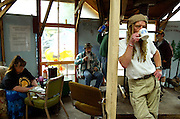 May 12, 2003 - Jack Tafari enjoys a cup of coffee as he joins others in the community room at Dignity Village in Portland, OR. He, as the leader, is 1 of 65 homeless people who have taken up residence on the leaf recycling land near the airport with the city's permission. They are being asked to leave again by October and find a new home.