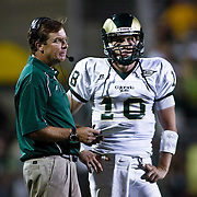 SHOT 9/6/09 7:58:21 PM - Colorado State head football coach Steve Fairchild talks over a play with his quarterback Grant Stucker (#18) during a timeout against Colorado during the second half of the 2009 Rocky Mountain Showdown at Folsom Field in Boulder, Co. Colorado State upset Colorado 23-17 in the game. (Photo by Marc Piscotty / © 2009)