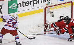 May 19, 2012; Newark, NJ, USA; New Jersey Devils goalie Martin Brodeur (30) makes a diving glove save on New York Rangers right wing Ryan Callahan (24) during the second period in game three of the 2012 Eastern Conference Finals at the Prudential Center.