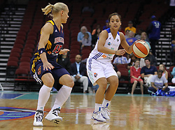 June 3, 2012; Newark, NJ, USA; New York Liberty guard Leilani Mitchell (5) dribbles the ball while being defended by Indiana Fever guard Erin Phillips (13) during the first half at the Prudential Center.