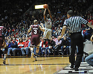 "Ole Miss' LaDarius White (10) vs. Mississippi State's Colin Borchert (3) at the C.M. ""Tad"" Smith Coliseum on Wednesday, February 6, 2013."