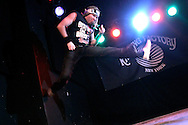 David 'Green Manalishi' Katz performs during the regional finals of the US Air Guitar Champions in New York March 2, 2006. The winner of the contest goes on to the national championship for a chance to represent America in the world championship in Finland.